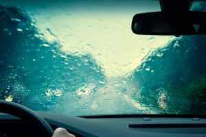 A windshield heavily obscured by rain
