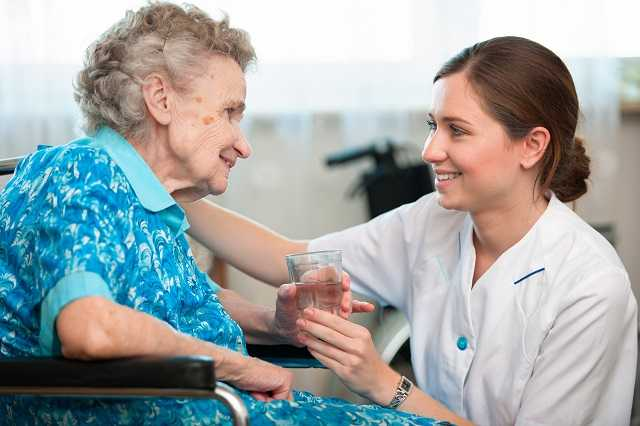 Caregiver Taking Care Senior Woman