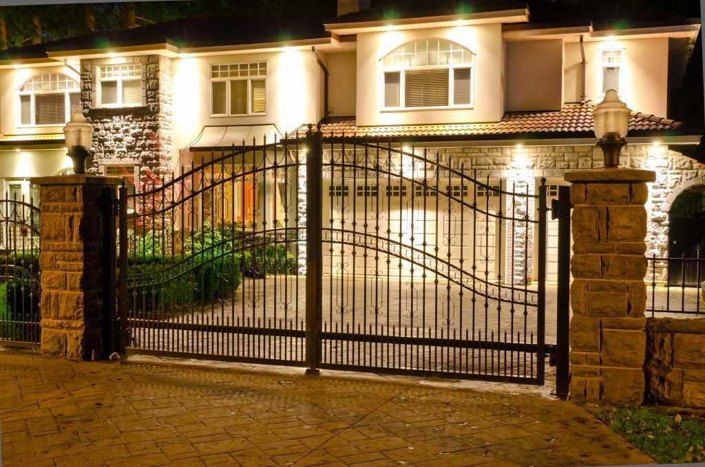 A Luxury House with a Driveway Gate