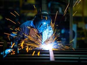 Man working on a steel product