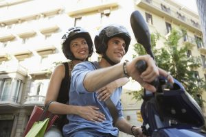 Man and woman wearing their helmets for safety ride
