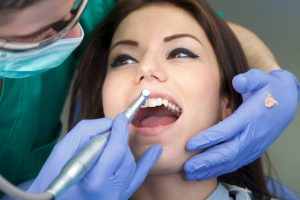 Woman having her teeth cleaned