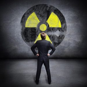 Man Looking at a Radiation Sign