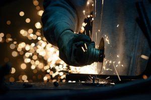 Metal Grinding on Steel Pipe