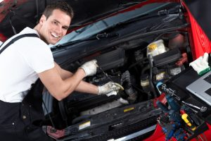 Man changing the oil of the car