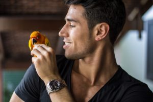 Man entertaining his bird