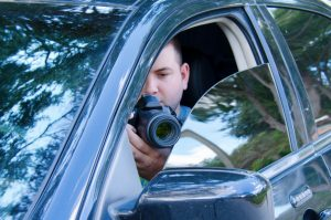 Private investigator on a stakeout
