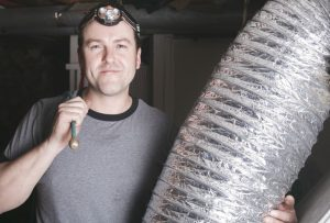 Man Holding an Air Duct