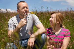 Man enjoying his e-cig with his woman