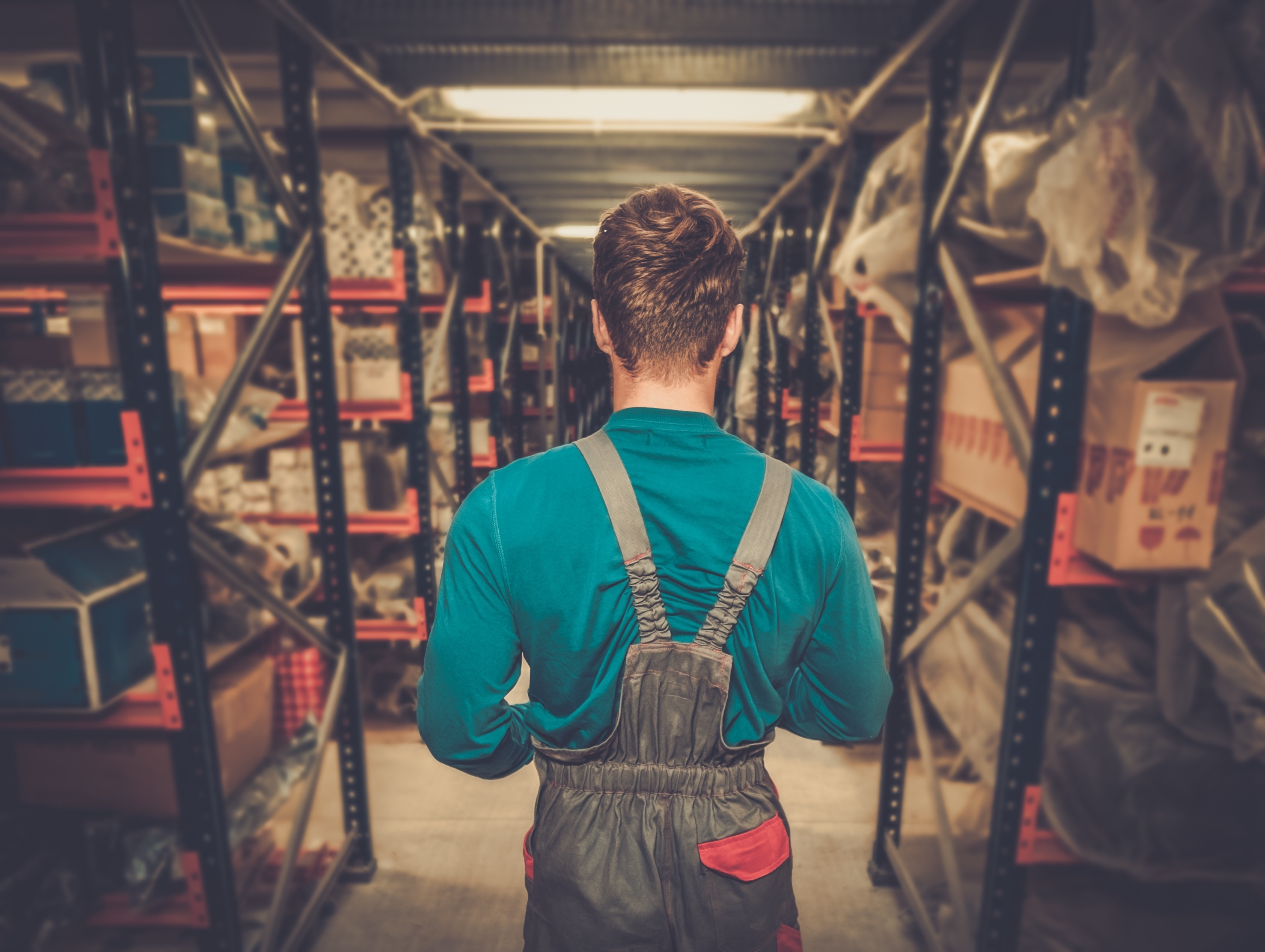 Worker in a warehouse full of shelves