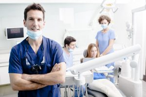 Dentists and patient in clinic