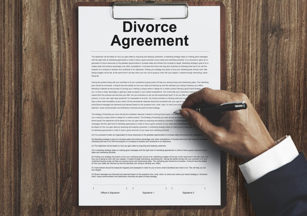 A divorce agreement being signed