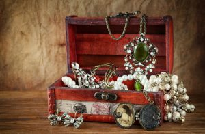 Vintage jewelry in antique wooden jewelry box