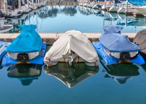 Covered boats on a dock