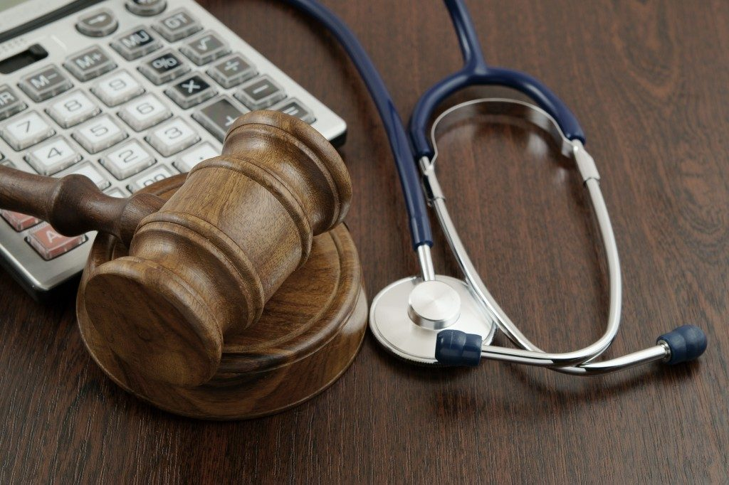 Stethoscope, gavel, and a calculator