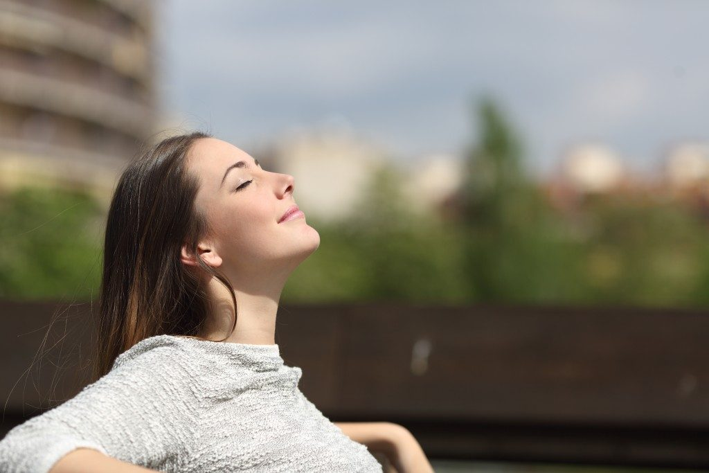 woman in the park breathing fresh air