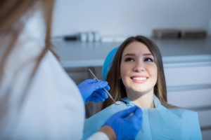 Woman Undergoing Dental Treatment