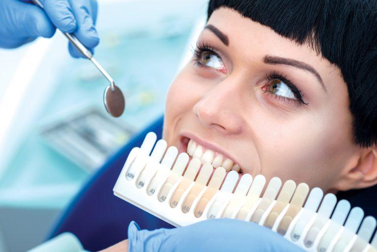 a woman getting a teeth whitening treatment