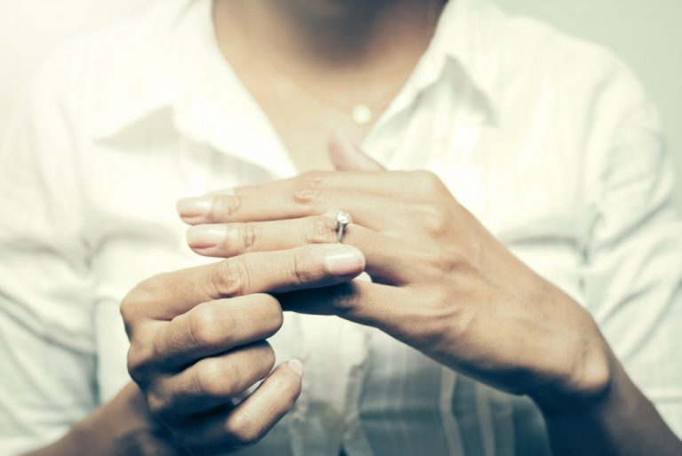 Woman removing her wedding ring