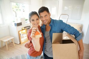 Couple showing keys to their new home