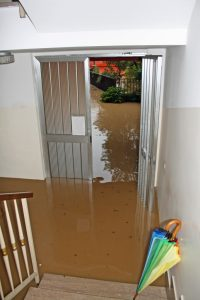 front porch of house flooded