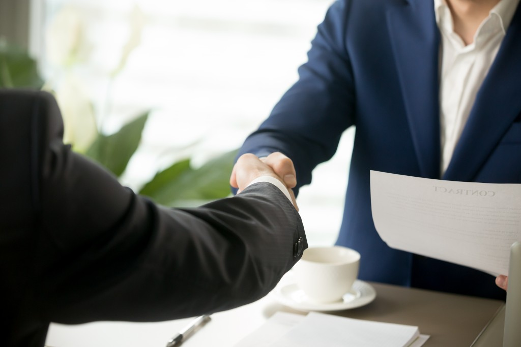 Businessman shaking hands after deal