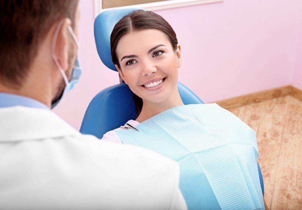 Woman listening to dentist's advice