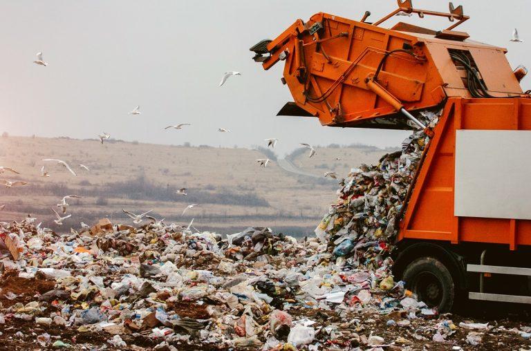 Garbage truck dumping plastics