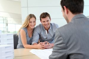 Real estate expert talking to homebuyers