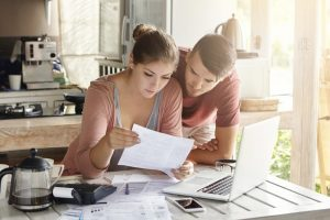 Homeowners calculating their payment