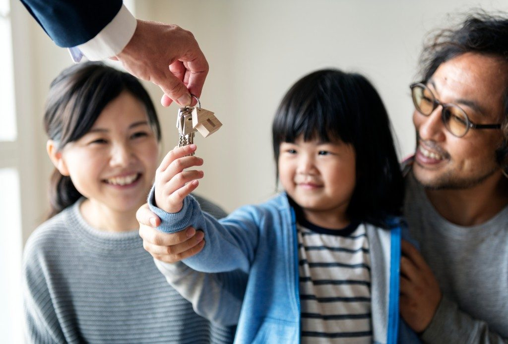 Child holding new house keys