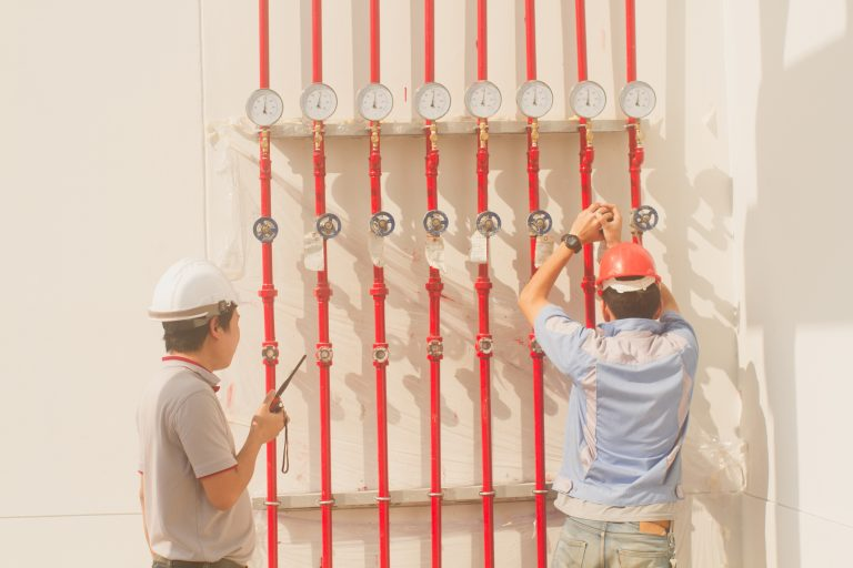 workers checking the system