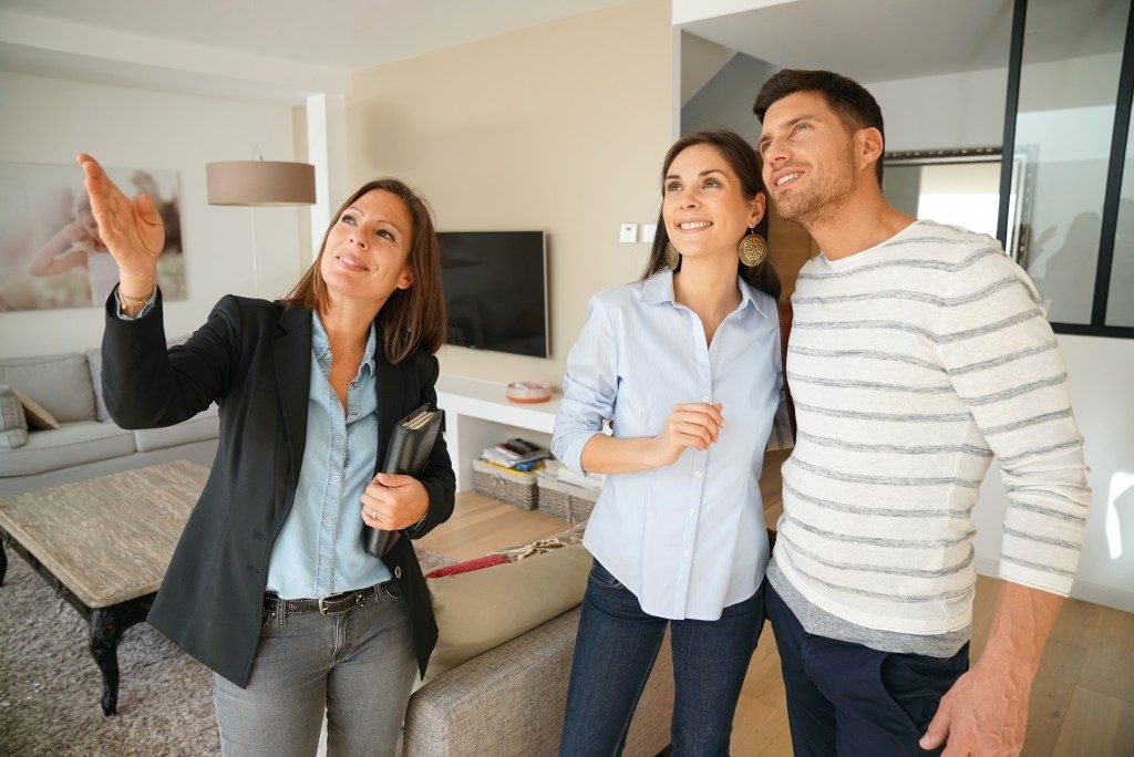 Real estate agent touring a couple around the house