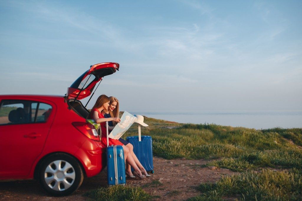 Travellers on a rental car