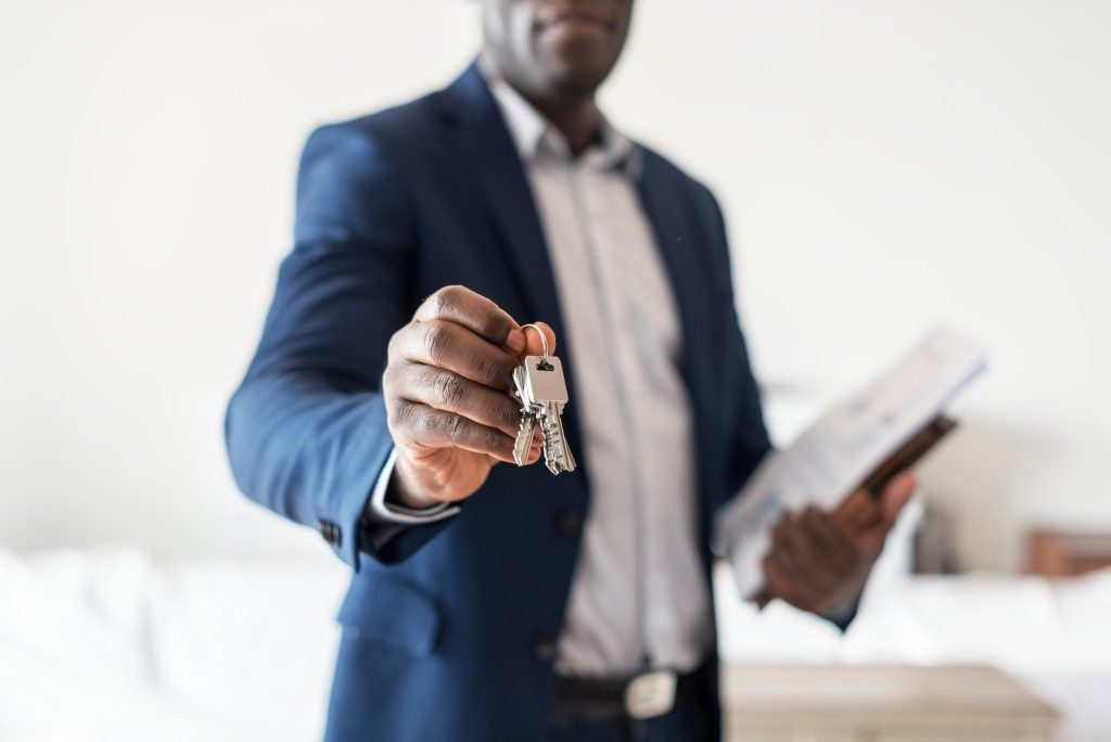 handing out keys to a property