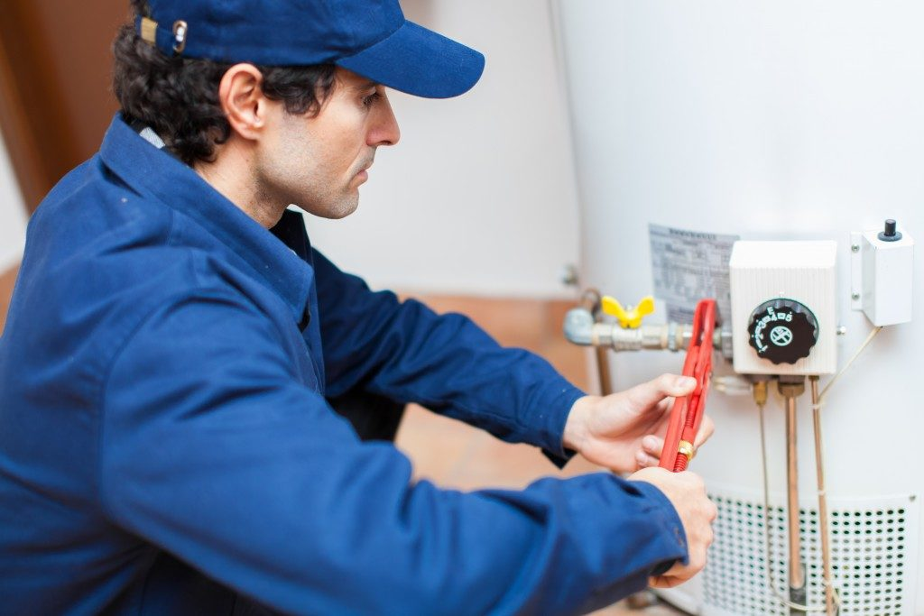 Plumber fixing an hot-water heater