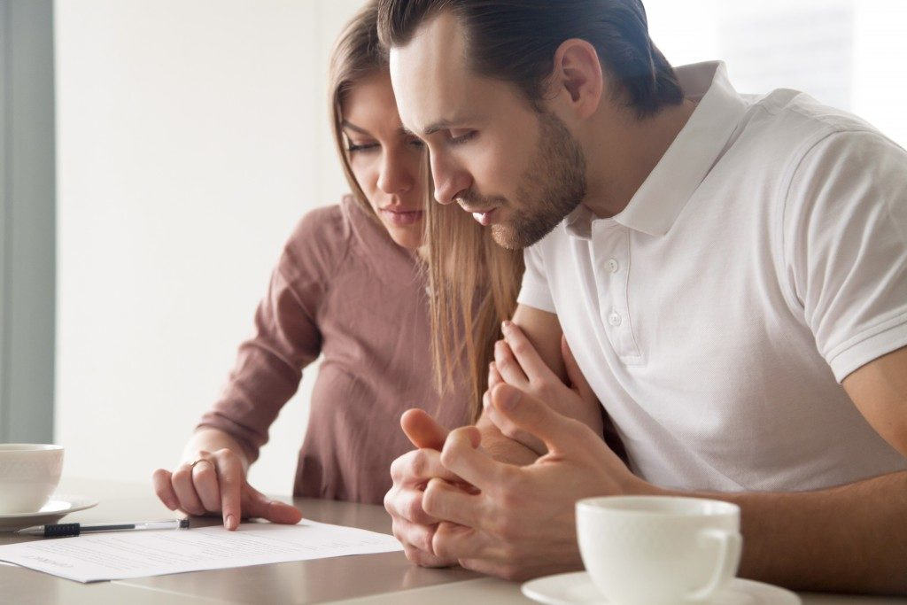 couple checking home sale contract