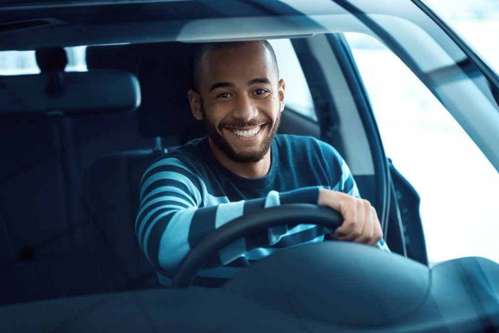 Smiling man in his car