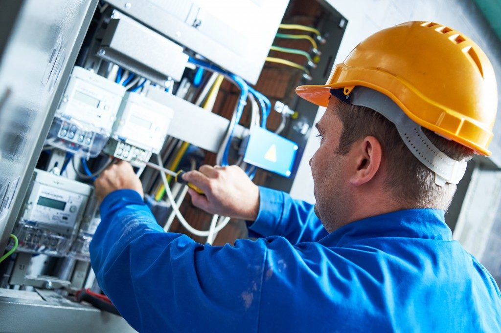 a man doing an electrical work