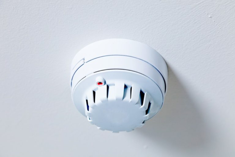 A smoke detector fire alarm installed in a house