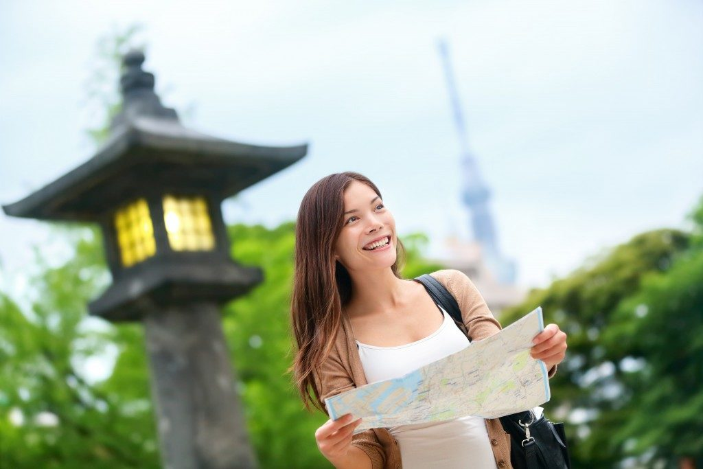 travelling woman holding a map