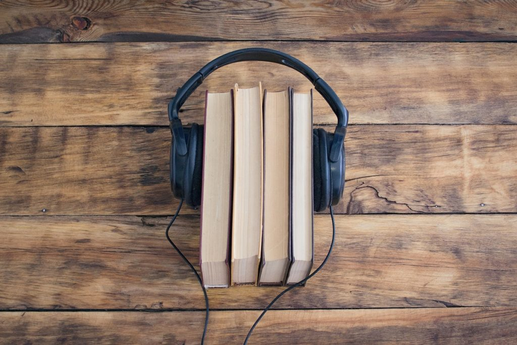 Books and headphone on a wooden table