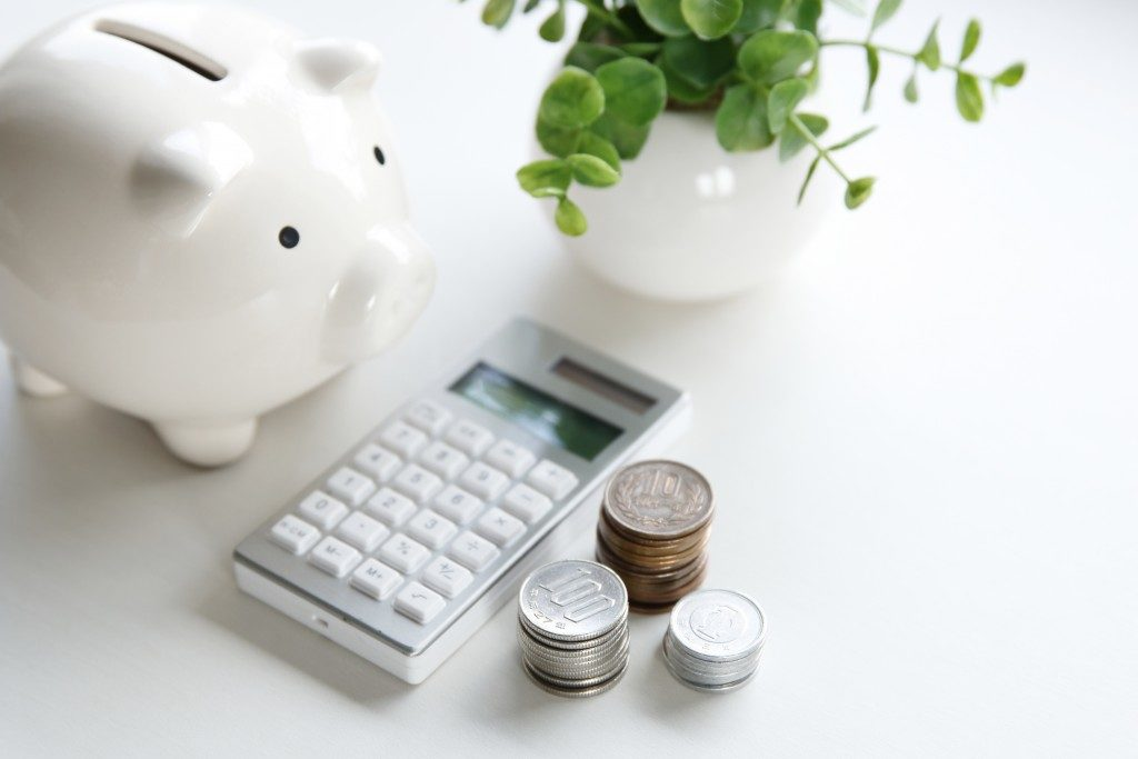 Coins, calculator and piggy bank