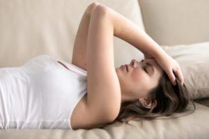 Woman experiencing migraine