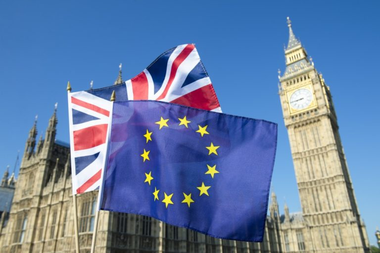 European Union and British Union Jack flag flying in front of Big Ben and the Houses of Parliament at Westminster Palace