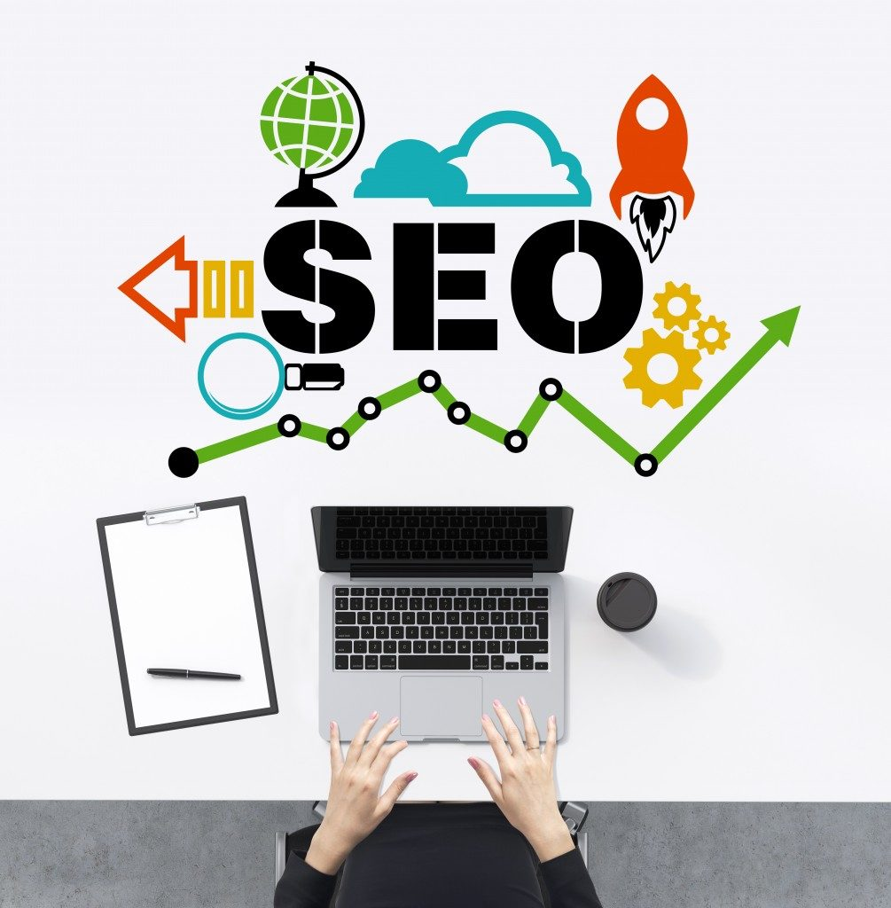Search Engine Optimisation concept with laptop and man typing