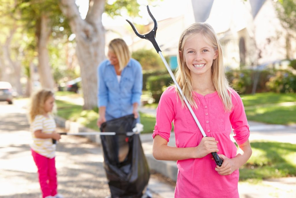 mother and daughters cleaning in the neighborhood