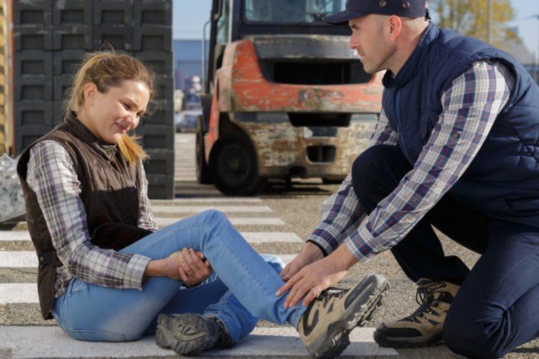man treating an injured woman