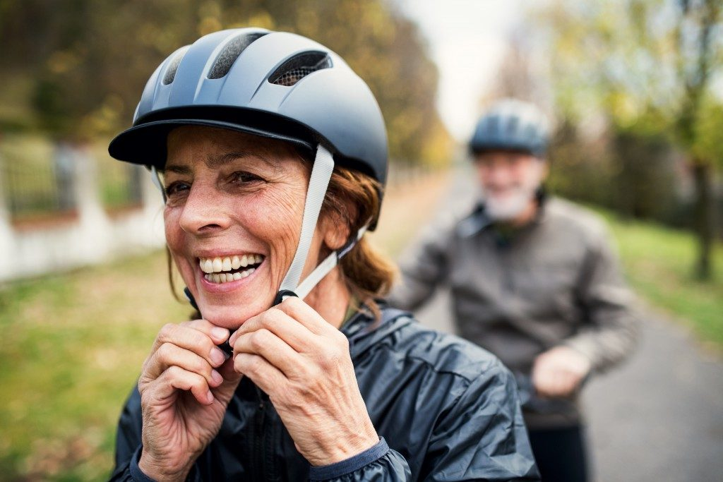 Couple wearing helmets for cycling