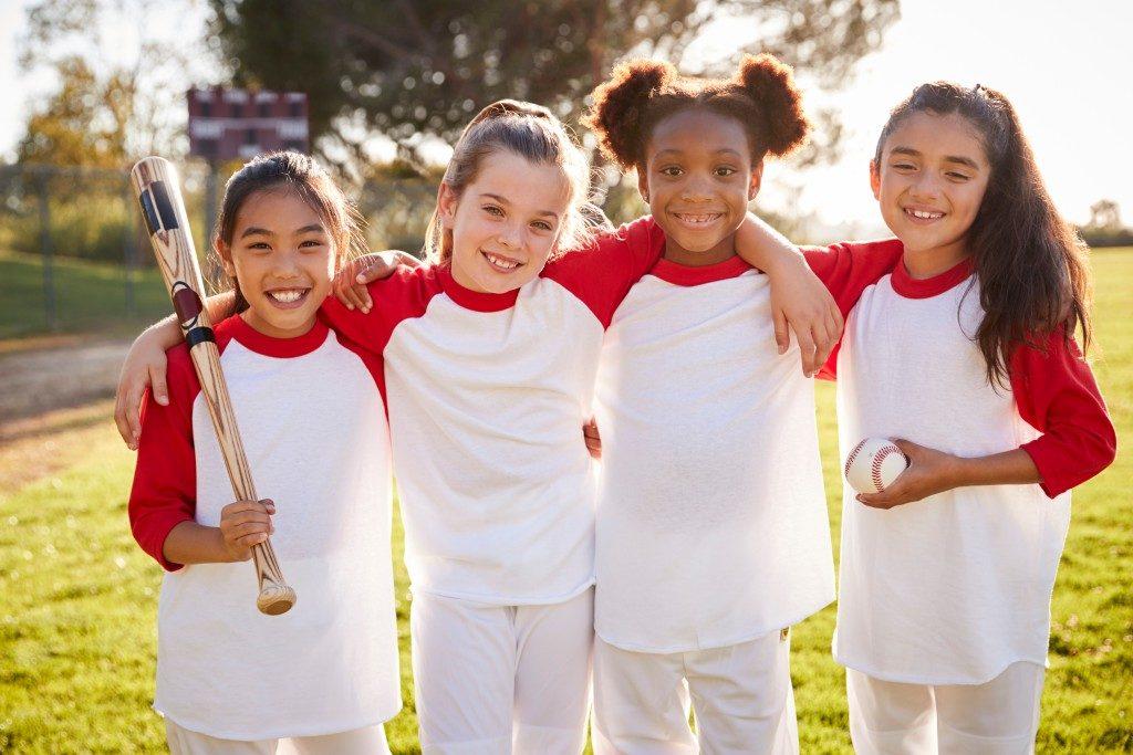 Little girls playing Baseball